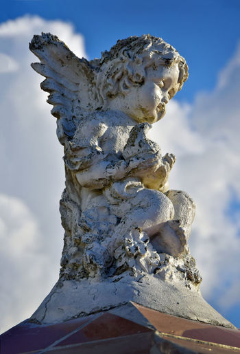 Cherub angel statue in a Yucatan, Mexico cemetery Cemetery Cemetery Photography Angel Cherub, Close-up Cloud - Sky Day Human Representation Low Angle View No People Old Outdoors Religion Representation Sculpture Sky Statue Stone Yucatan Mexico