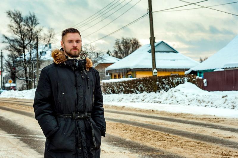 Full length of man standing in snow