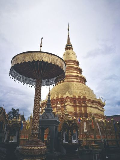Low angle view of temple against clouds