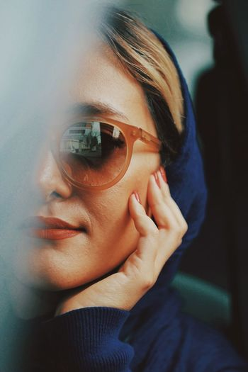 Close-up portrait of woman wearing sunglasses