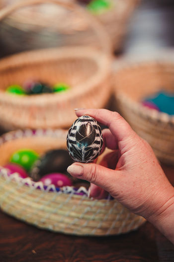 Cropped hand of woman holding easter egg
