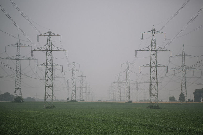Cable Day Electricity  Electricity Pylon Field Fog Fuel And Power Generation Grass Landscape No People Power Line  Power Supply Strommast Symmetrical Symmetry Technology