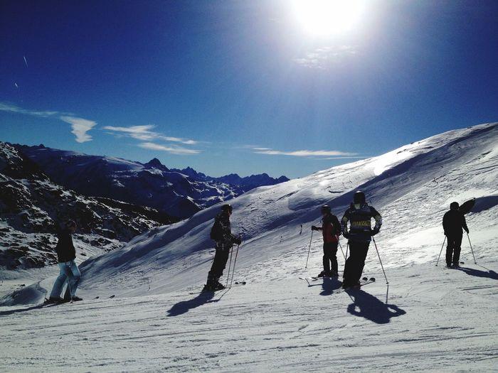 People Skiing On Snow Landscape
