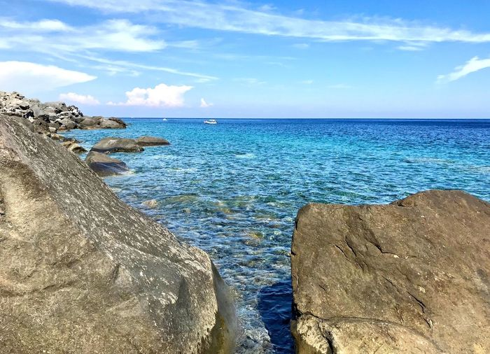 Sea Water Sky Beach Beauty In Nature Scenics - Nature Horizon Over Water Cloud - Sky Sunlight Idyllic Rock Solid Blue Tranquil Scene Nature Day Land Tranquility Horizon No People