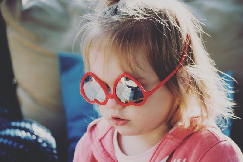 😍 EyeEm Best Shots This Week On Eyeem Headshot Child Childhood Glasses Portrait Real People Girls Females One Person Lifestyles Close-up Sunglasses Fashion Innocence Outdoors Day Women Front View
