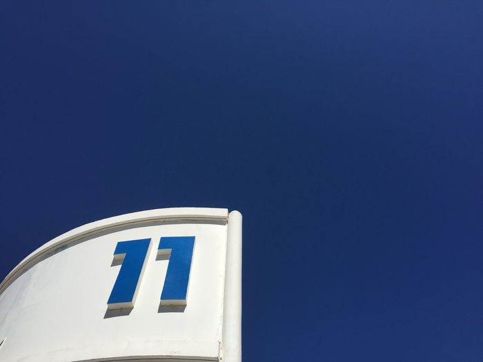 11 11 1 1 Blue Low Angle View Copy Space No People Clear Sky Sky Day Communication Architecture White Color Building Exterior Guidance High Section Outdoors Tower Number Built Structure Nature Sign Sunny