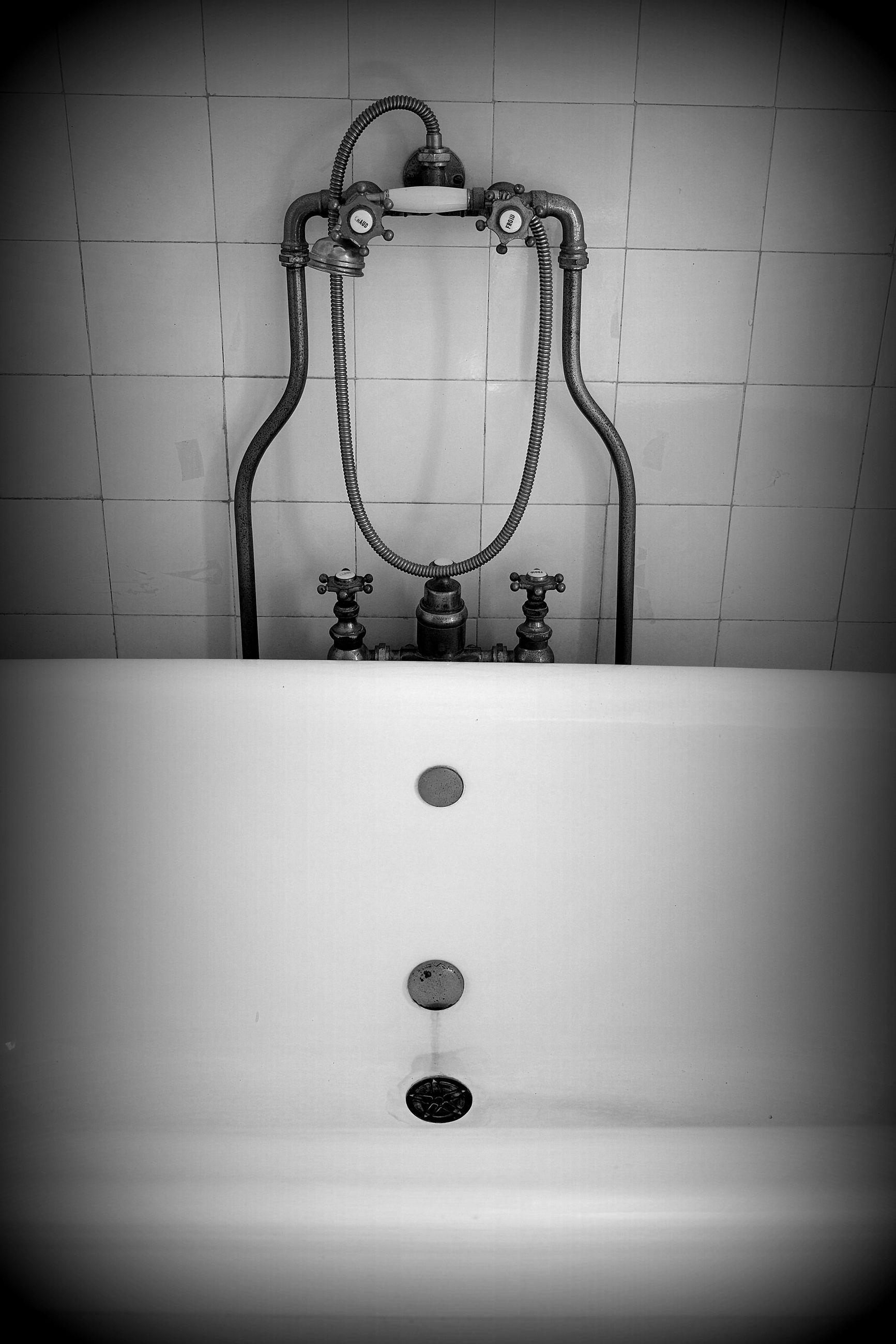 bathroom, domestic bathroom, indoors, plumbing fixture, black and white, tap, sink, domestic room, home, white, faucet, hygiene, monochrome, no people, bidet, monochrome photography, household equipment, shower, tile, vignette, black, flooring