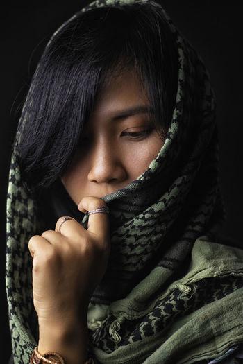 Close-up of woman wearing headscarf