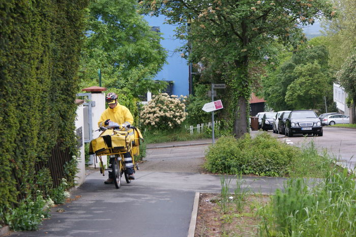 Delivery Man Delivery On Bike European Postman German Postman Mail Delivery Postman Postman On Bike Rain Gear Urban Yellow
