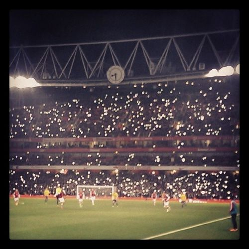 Friday Night Lights. Thousands of fans turn to their phones to help out when part of the floodlights fail during Arsenal vs Coventry in the FA Cup, January 24th 2014 Afc Ccfc