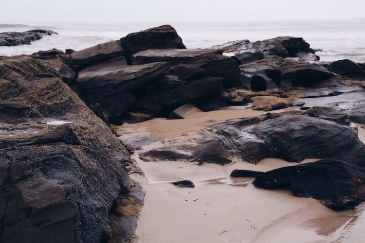 Scenic view of rocks at seaside