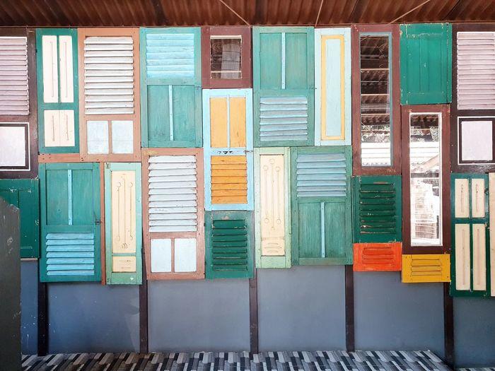 Multi colored doors in building