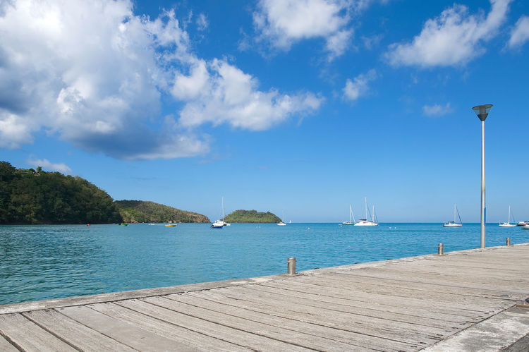 Anse a l'Ane - Fort de France - Martinique - Caribbean island Anse Antilles Atlantic Beauty In Nature Blue Caribbean Caribbean Sea Cloud - Sky Day Jetty Martinique Mitan Nature Nautical Vessel No People Ocean Outdoors Pointe Du Bout Scenics Sea Sky Sunlight Tranquility Tropical Water