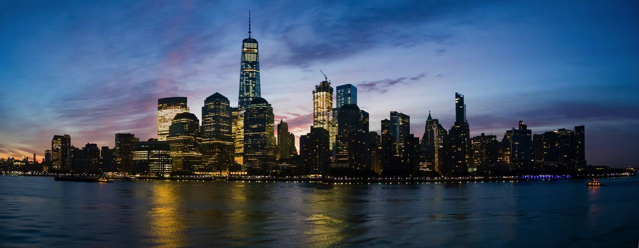 Manhattan lit up at dusk
