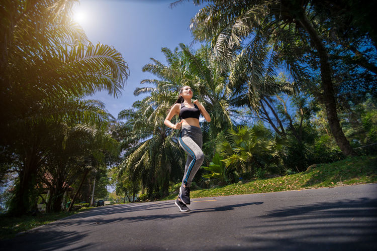 Pretty sport woman jogging in the park, running outdoors in nature Athlete Beautiful Diet Happiness Nature Practice Run Activity Beauty Cute Energy Excercise Female Fit Fitness Healthy Jogging Lifestyles Outdoor Park Pretty Sexygirl Sixpack Sport Sportwear