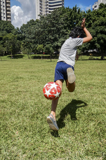 Full length of boy playing on field