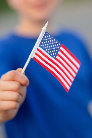 USA flag One Person Holding Human Hand Flag Patriotism Human Body Part Focus On Foreground Real People Blue Close-up Hand Red Lifestyles Men Shape Finger Small