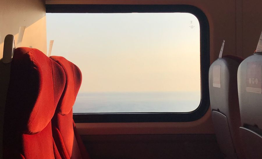 Mood North Sea Train Seat Train Window No People Vehicle Interior Mode Of Transportation Indoors  Orange Color Transportation Red Sunset Sky Nature Travel Seat Sunlight Vehicle Seat Public Transportation