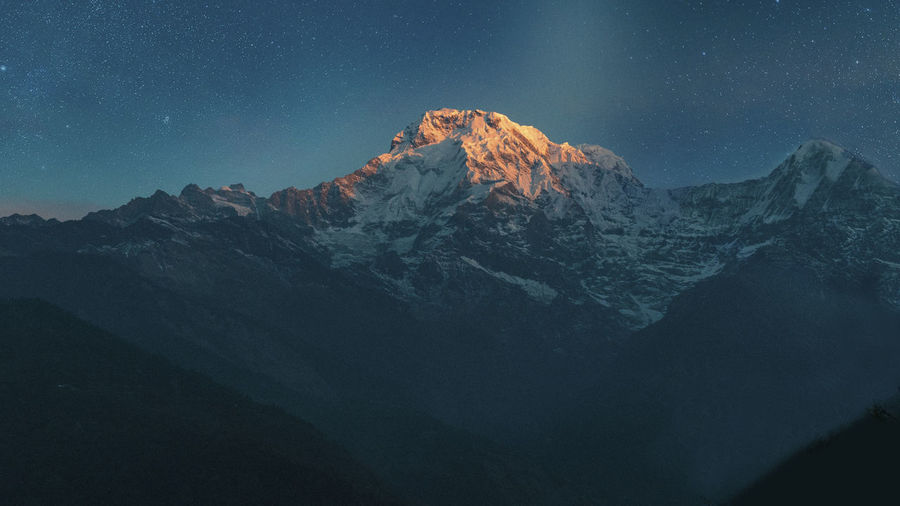 Scenic View Of Machapuchare Snowcapped Mountains Against Sky At Sunrise