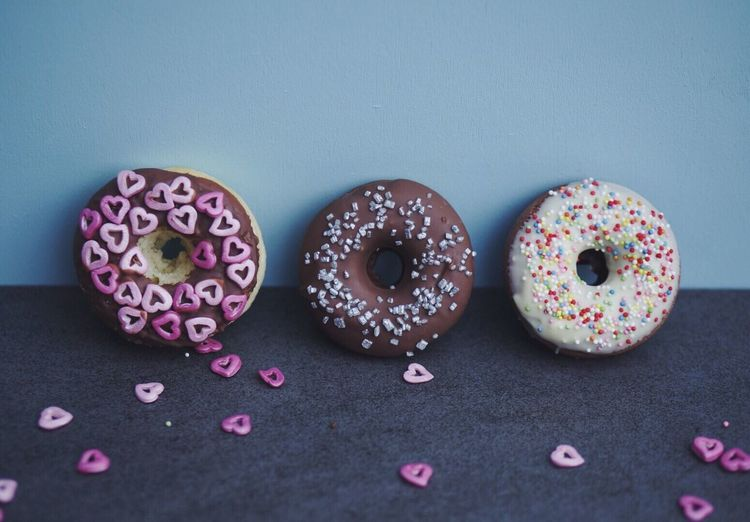 High Angle View Of Donuts Leaning On Wall