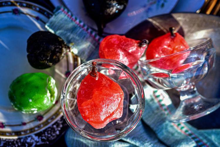 High angle view of fruits on glass table