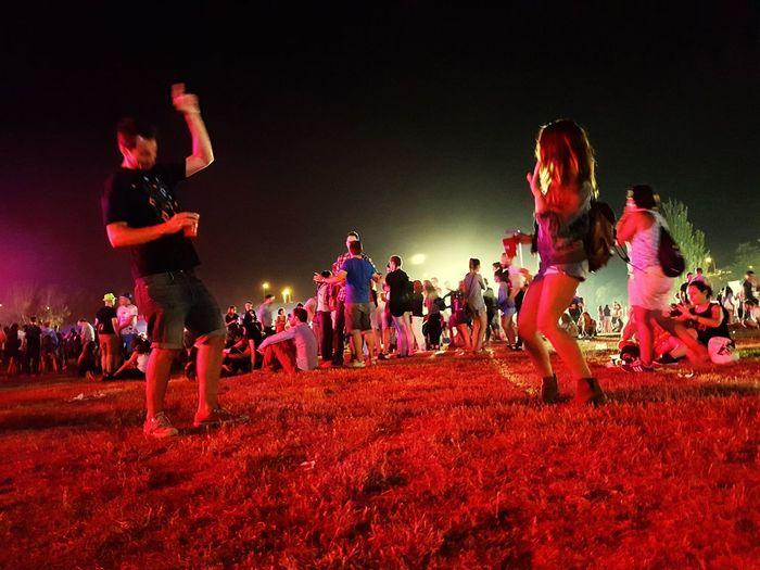 People playing guitar at night