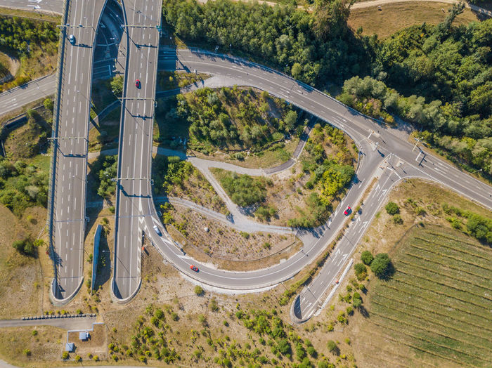Transportation Road High Angle View Highway Plant Tree Mode Of Transportation Land Vehicle No People Day Nature Connection Motor Vehicle Car Aerial View Travel Multiple Lane Highway Outdoors Landscape Motion