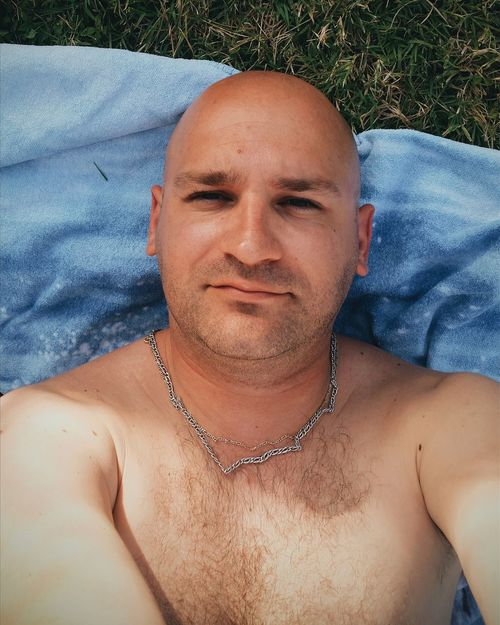 EyeEm Selects Portrait Looking At Camera Only Men One Person One Man Only Shaved Head Headshot Mid Adult Men Shirtless Real People Adults Only Men Leisure Activity Adult Outdoors Day Smiling People Close-up