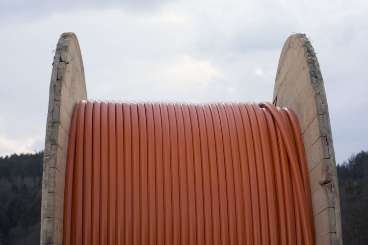Close-up of metal structure on beach against sky