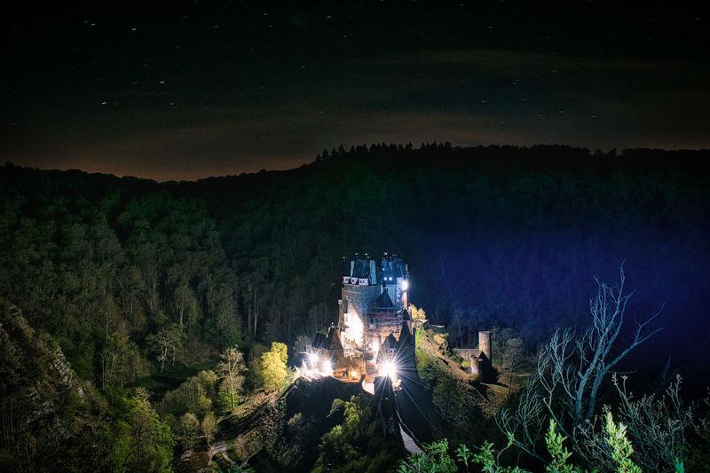 High angle view of illuminated trees at night