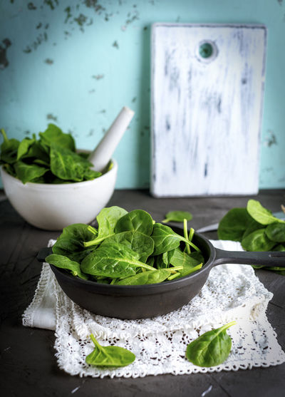 Bowl Close-up Cooking Pan Eating Utensil Food Food And Drink Freshness Green Color Healthy Eating High Angle View Kitchen Utensil Leaf No People Plant Part Selective Focus Spinach Still Life Table Vegetable