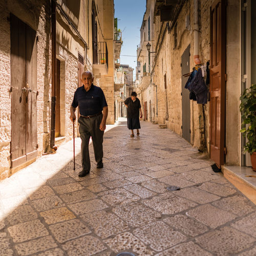 Puglia Adult Alley Architecture Building Building Exterior Built Structure Casual Clothing City Day Footpath Full Length Outdoors Paving Stone People Real People Rear View Sony Sonyalpha Street Sunlight Togetherness Two People Walking Women Zeiss Streetwise Photography My Best Photo
