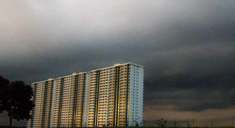 Apartment Architecture Building Exterior Built Structure City Cityscape Cloud - Sky Day Low Angle View Nature No People Outdoors Reflection Sky Skyscraper Storm Cloud Sun Reflection Sun Reflection On Building Sunlight Sunset Sunshine Tall Buildings Tree White Sky Yellow