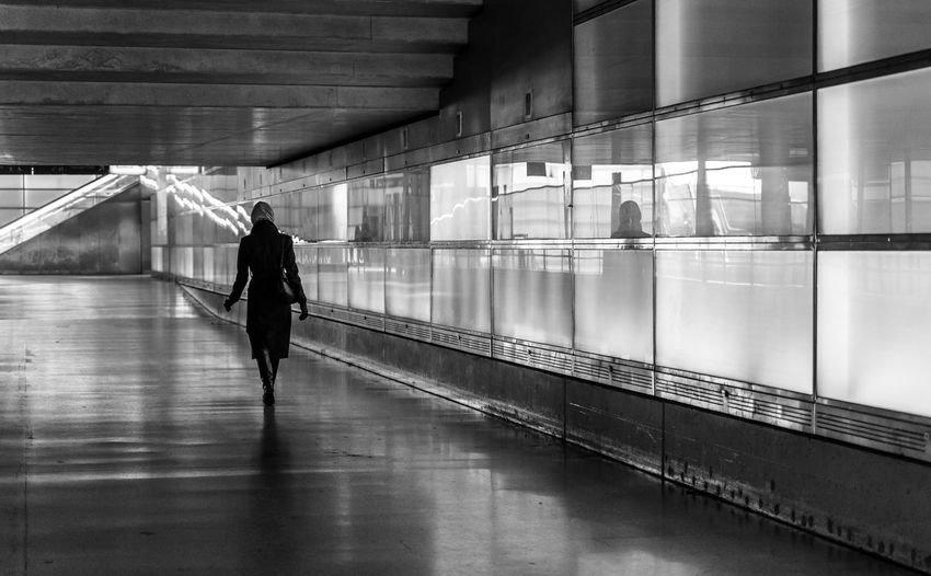 Architecture Reflection Motion Real People Modern Walking Black And White Street Photography Women Rear View Travel Illuminated Transportation Railing Underpass Indoors  Futuristic Lifestyles Full Length Flooring One Person Leisure Activity Built Structure Incidental People Glass - Material Krull&Krull Black And White Streetwise Photography The Art Of Street Photography Krull&Krull Streetphotography Adult Indoors