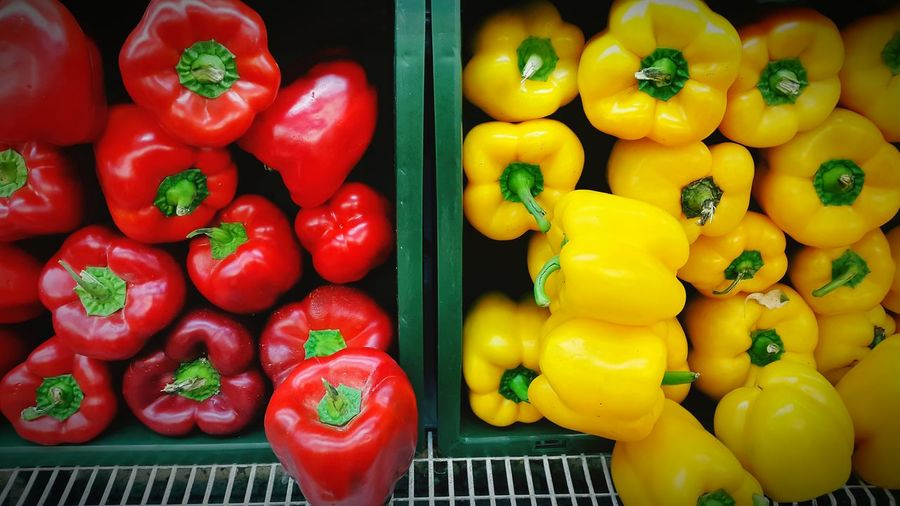 High angle view of red and yellow bell peppers at market