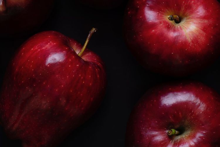 Fresh red apple on a black Dark Red Healthy Eating Fruit Food And Drink Food Apple - Fruit Freshness Close-up Apple Still Life Group Of Objects Black Background Studio Shot Healthy Lifestyle
