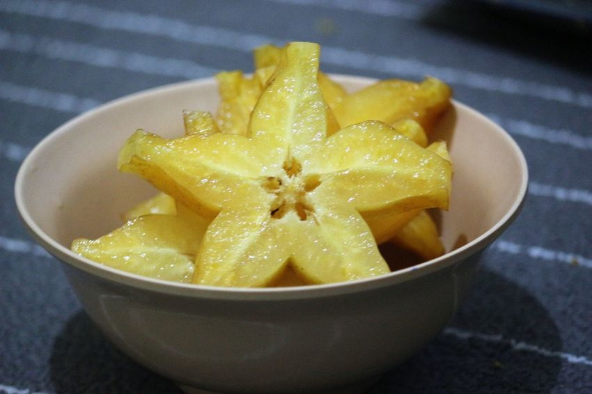 A bowl of sliced star fruit Star Fruit  Bowl Close-up Day Food Food And Drink Freshness Fruit Healthy Eating Indoors  No People Ready-to-eat SLICE Yellow Food Stories