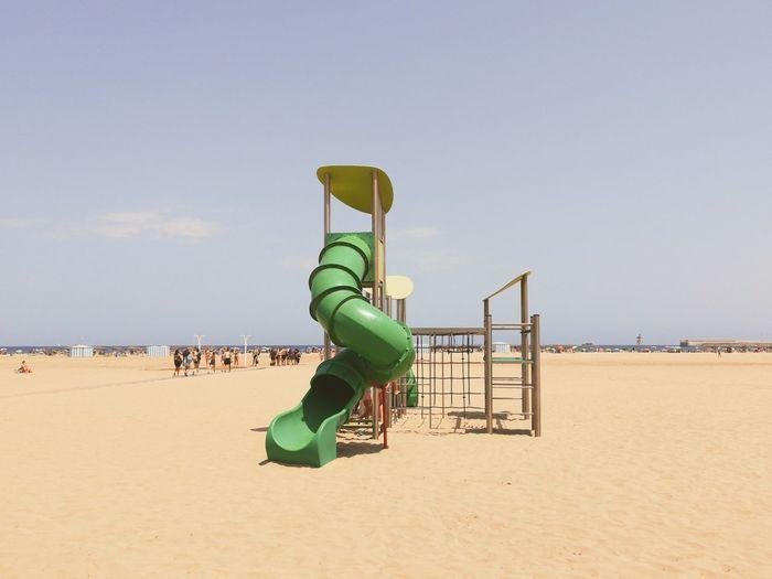 Slide on beach