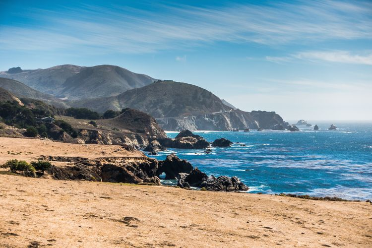 Route 1 Pacific Coast Highway Sky Mountain Sea Water Beauty In Nature Scenics - Nature Nature Land Rock Day Beach Tranquil Scene Rock - Object Tranquility Mountain Range Rock Formation Cloud - Sky Idyllic Solid Outdoors