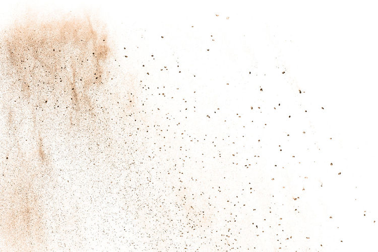 Defocused image of powder paint against white background