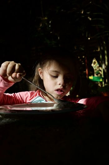 Close-up of girl eating at home