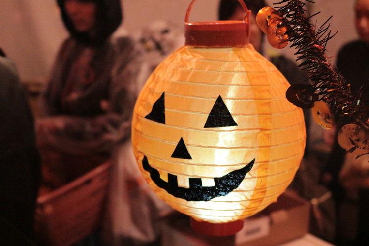 Close-Up Of Jack O Lantern Shape Illuminated Lamp At Home
