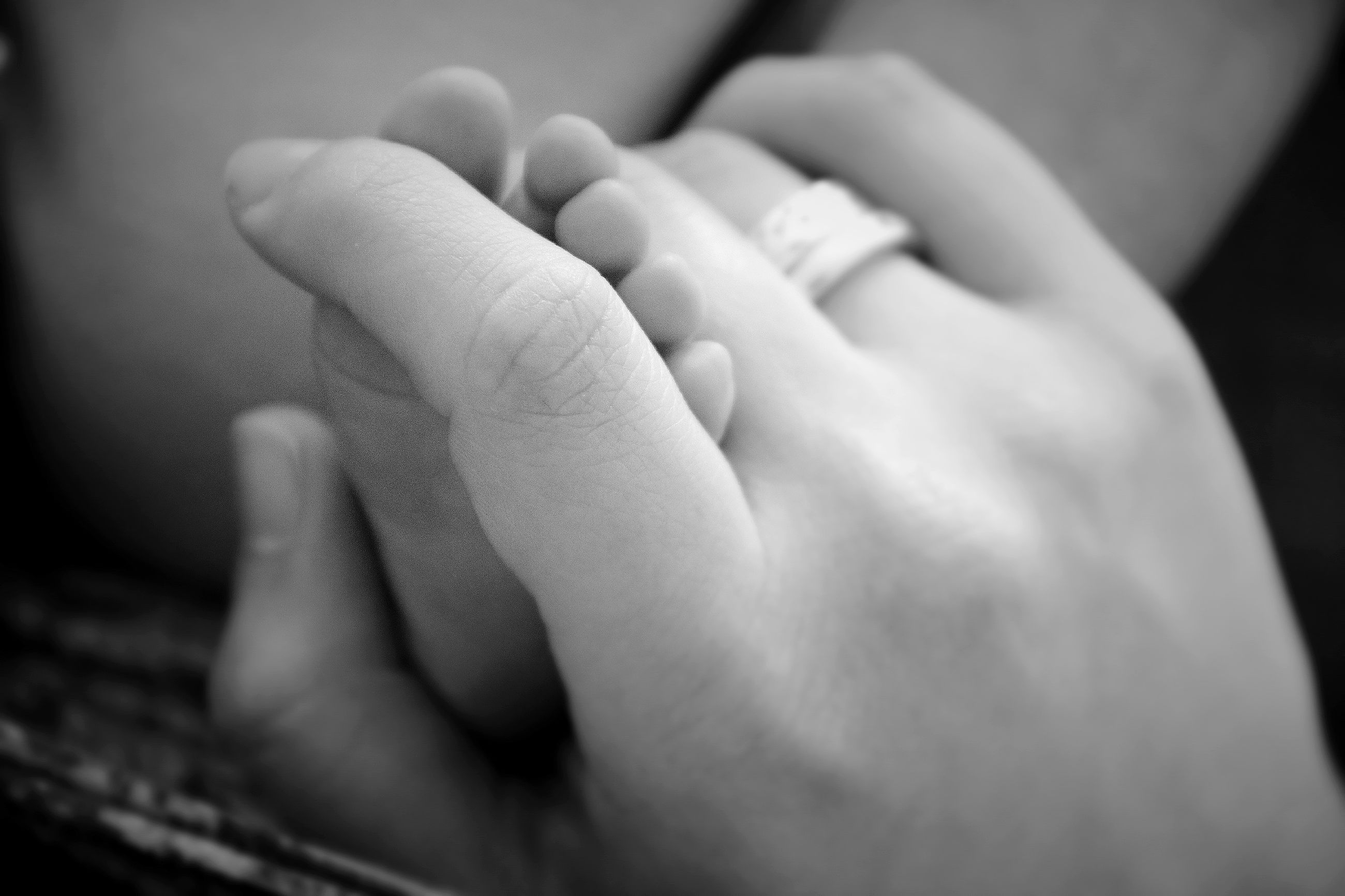 person, indoors, part of, human finger, lifestyles, close-up, baby, cropped, love, holding, unknown gender, togetherness, bonding, barefoot, holding hands