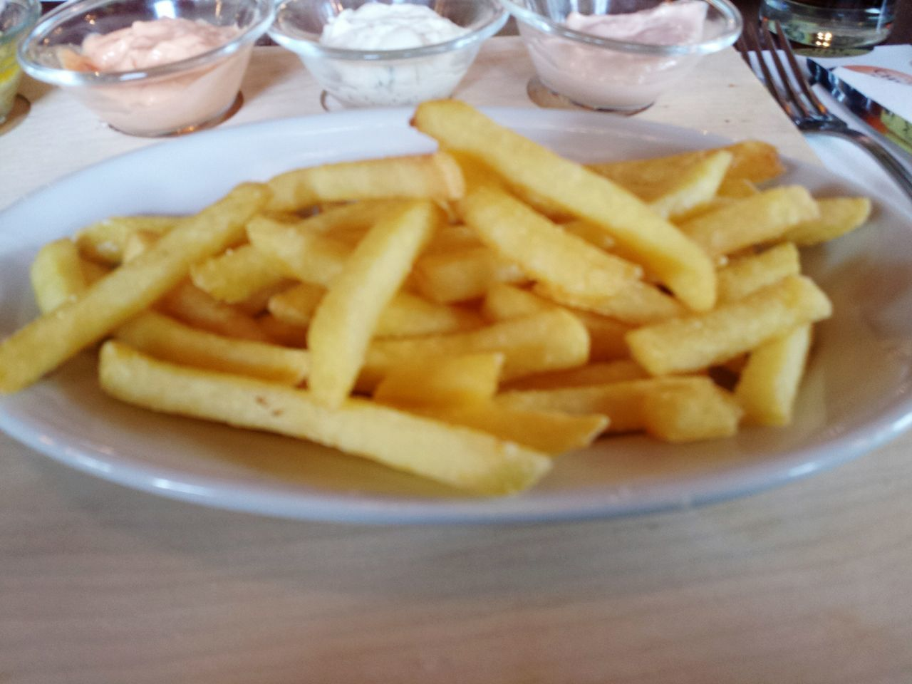french fries, food and drink, prepared potato, food, unhealthy eating, still life, table, no people, freshness, plate, indoors, close-up, ready-to-eat, deep fried, dip, fast food, day