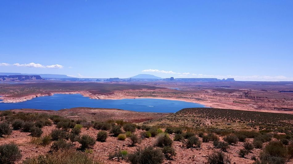 vista view of Lake Powell Arizona Beauty In Nature Blue Coastline Day Desert Oasis Hill Horizon Over Land Idyllic Lake Lake Powell Landscape Nature No People Non Urban Scene Non-urban Scene Outdoors Plant Remote Scenics Sky Tranquil Scene Tranquility Travel Destinations Water