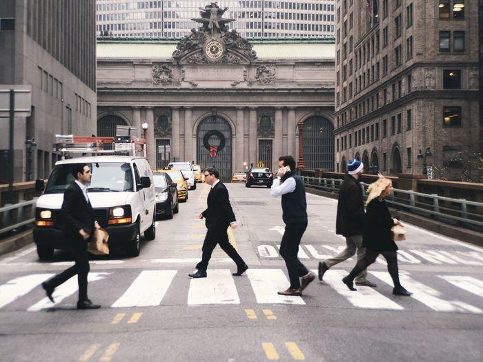 Full length of woman walking on city street