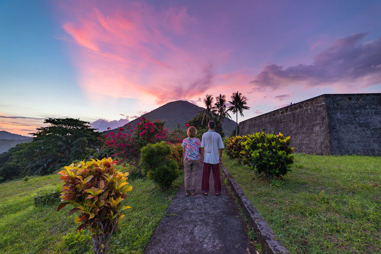 Plant Sky Sunset Rear View Full Length Adult Standing Nature Women Togetherness Cloud - Sky Mountain Leisure Activity Couple - Relationship Two People Men Beauty In Nature Love People Real People Positive Emotion Outdoors