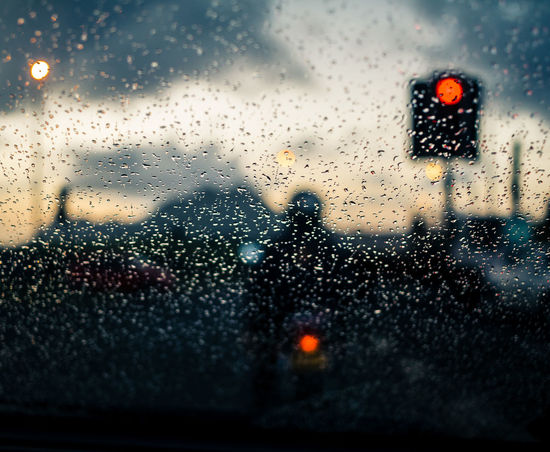 At the traffic light. Mauritius Photography Sunset Traffic Lights Glass - Material Window Drop No People Dusk Car Illuminated Water Sunset Windshield Looking Through Window Close-up Nature Sky EyeEmNewHere