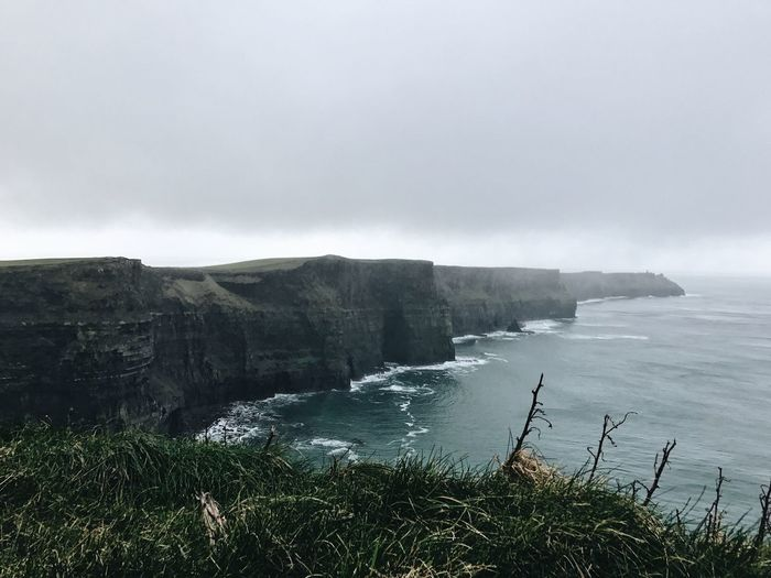 12.55 at Cliffs of Moher // Nature Water Beauty In Nature Scenics Sky Tranquility Idyllic Sea No People Outdoors Day Tranquil Scene Mountain Landscape Power In Nature Waterfall The Great Outdoors - 2017 EyeEm Awards Let's Go. Together.