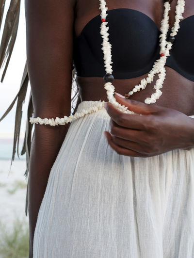 Black woman wearing shell necklace